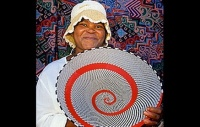 Zulu artisan displaying her creation