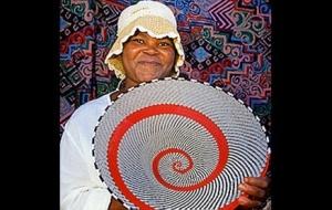 Zulu artisan displaying her creation